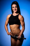 Bikiny fitness copmetitor - fit woman poses after workout Stock Photos