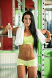 Bikiny fitness copmetitor - fit woman poses after workout Stock Photography