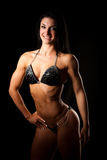 Bikiny fitness copmetitor - fit woman poses after workout Stock Photo