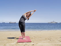 Bikram yoga arda chandrasana pose Royalty Free Stock Photos