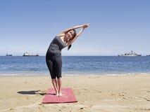 Bikram yoga arda chandrasana pose. Yoga teacher practising at the beach pose arda chandrasana Royalty Free Stock Photos