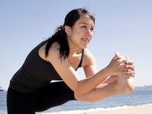 Bikram yoga dandayamana janushirasana pose. Yoga teacher practising at the beach pose dandayamana janushirasana Royalty Free Stock Photography