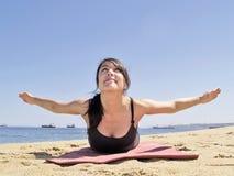Bikram yoga paorna salabhasana pose frontal view. Yoga teacher practising at the beach pose paorna salabhasana Royalty Free Stock Photography