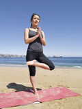 Bikram yoga tadasana pose at beach Stock Photos