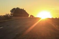 Bil från solnedgång Royaltyfri Bild