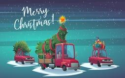 Bil med den gåvaaskar och lastbilen med granträdet och den stora glänsande stjärnan Arkivbild