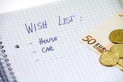 Bil och hus på önskelista Royaltyfria Foton