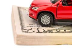 Bil på dollarräkningar Arkivbild