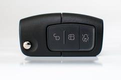 Bil som är nyckel- med fjärrkontroll som isoleras på vit Royaltyfria Bilder