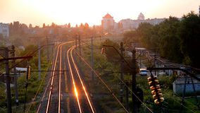 Bila Tserkva, Ukraine. July 22, 2016: - Timelapse railroad tracks at sunset sunrise in the city. Railroad tracks at sunset sunrise in the city, Timelapse fast stock footage