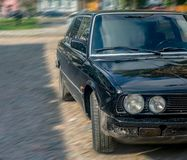 Bila tserkva, Ukraine, September 18, 2018: front view of the old dirty black car parked on the square royalty free stock photo