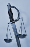 Bilancia della giustizia della spada Fotografia Stock
