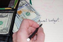bilancio per il viaggio Lista e soldi fotografia stock libera da diritti