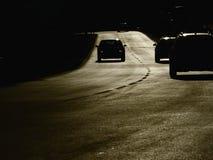 Bilar för gatasolnedgångkontur Fotografering för Bildbyråer