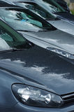 bilar isolerad radwhite Arkivfoton