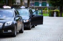 bilar taxar Fotografering för Bildbyråer