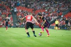 BILBAO, ESPANHA - 28 DE AGOSTO: Arda Turan e Oscar de Marcos na ação durante uma harmonia de liga espanhola entre Athletic Bilbao Fotos de Stock Royalty Free