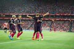 BILBAO, ESPANHA - 28 DE AGOSTO: Ivan Rakitic, Leo Messi e Denis Suarez comemorando um objetivo na harmonia espanhola de fósforo d Fotografia de Stock Royalty Free