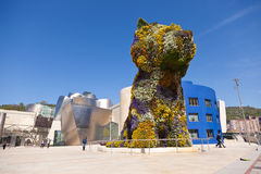 Bilbao Guggenheim Museum. Bilbao - April 5: Puppy is a sculpture by Jeff Koons, represents a West Highland Terrier. Manufactured form evokes the topiary of 18th Stock Photos