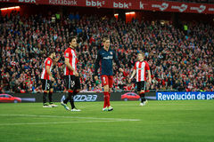 BILBAO, SPAIN - APRIL 20: Fernando Torres, Xabier Etxeita and Iker Muniain in the match between Athletic Bilbao and Athletico de M. Adrid, celebrated on April 20 Stock Photography