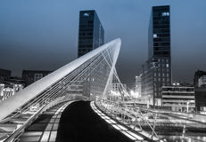Nightview of Zubizuri bridge and Isozaki towers in Bilbao, Spain. BILBAO, SPAIN - APRIL 02 Nightview of Zubizuri bridge and Isozaki towers in the background, in Stock Image