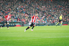 BILBAO, SPAIN - ARPIL 7: Iker Muniain and Aritz Aduriz in the match between Athletic Bilbao and Sevilla in the quarterfinals of th. E UEFA Europa League Royalty Free Stock Photography