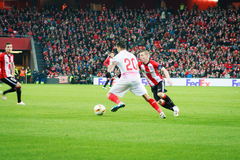 BILBAO, SPAIN - ARPIL 7: Iker Muniain and Vitolo Machin in the match between Athletic Bilbao and Sevilla in the UEFA Europa League Royalty Free Stock Photography
