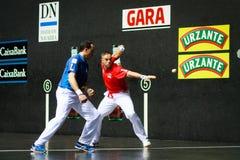 BILBAO, SPAIN - ARPIL 9: Juan Martinez de Irujo and Aimar Olaizola in the handball championship game of pairs before hitting the b Royalty Free Stock Photos