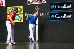 BILBAO, SPAIN - ARPIL 9: Juan Martinez de Irujo and Aimar Olaizola in the handball championship game of pairs before hitting the b Royalty Free Stock Photography