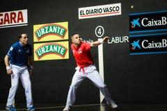BILBAO, SPAIN - ARPIL 9: Juan Martinez de Irujo and Aimar Olaizola in the handball championship game of pairs before hitting the b Stock Photo