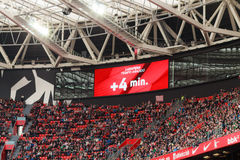 BILBAO, SPAIN - ARPIL 3: Video scoreboard indicates four minutes added, in the match between Athletic Bilbao and Granada, celebrat Royalty Free Stock Photos