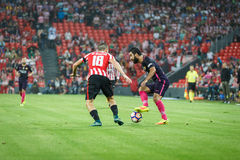 BILBAO, SPAIN - AUGUST 28: Arda Turan and Oscar de Marcos in action during a Spanish League match between Athletic Bilbao and FC B. Arcelona, celebrated on royalty free stock photos