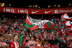 BILBAO, SPAIN - AUGUST 28: Fans of Athletic Club Bilbao move flags during a Spanish League match between Athletic Bilbao and FC Ba Royalty Free Stock Photos