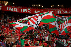 BILBAO, SPAIN - AUGUST 28: Fans of Athletic Club Bilbao move flags during a Spanish League match between Athletic Bilbao and FC Ba Stock Image