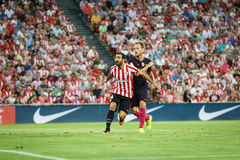 BILBAO, SPAIN - AUGUST 28: Ivan Rakitic of FC Barcelona, and Mikel Balenziaga of Ahtletic Bilbao, in action during the Spanish Lea Royalty Free Stock Image