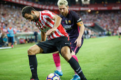 BILBAO, SPAIN - AUGUST 28: Leo Messi, FC Barcelona player, and Mikel Balenziaga, Bilbao player, in the match between Athletic Bilb Stock Photos