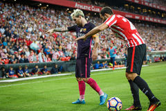 BILBAO, SPAIN - AUGUST 28: Leo Messi, FC Barcelona player, and Mikel Balenziaga, Bilbao player, in the match between Athletic Bilb Royalty Free Stock Photo