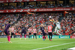 BILBAO, SPAIN - AUGUST 28: Leo Messi, Gorka Iraizoz and Aritz Aduritz disputing the ball in the the match between Athletic Bilbao Royalty Free Stock Images