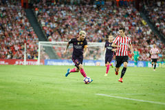 BILBAO, SPAIN - AUGUST 28: Lionel Messi, FC Barcelona player, and Markel Susaeta, Bilbao player, in the the match between Athletic Royalty Free Stock Photography