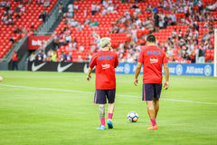 BILBAO, SPAIN - AUGUST 28: Lionel Messi and Luis Suarez in the heating of the match between Athletic Bilbao and FC Barcelona, cele Royalty Free Stock Photos