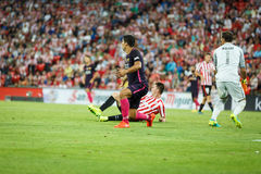 BILBAO, SPAIN - AUGUST 28: Luis Suarez, FC Barcelona player, and Gorka Iraizoz, Bilbao goalkeeper, during the match between Athlet Royalty Free Stock Image