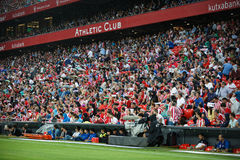 BILBAO, SPAIN - AUGUST 28: The public covered with umbrellas to avoid the rain during the match between Athletic Bilbao and FC Bar. Celona, celebrated on August Royalty Free Stock Photo
