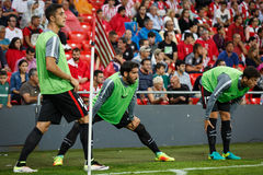 BILBAO, SPAIN - AUGUST 28: Raul Garcia, Mikel Vesga and Xabier Etxeita, Athletic Club Bilbao players, in heating during a Spanish Royalty Free Stock Photography