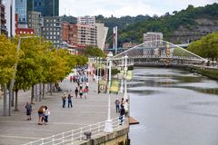 BILBAO, SPAIN, CIRCA AUGUST 2018, people walking next to the river stock photography