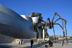 Bilbao, Spain. The Guggenheim Museum, built by architect Frank Gehry and the Mama`, a spider sculpture created by the sculptress Louise Bourgeois Royalty Free Stock Images