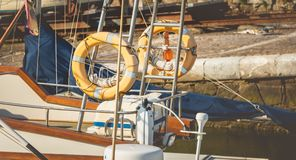 Close up on sun-bleached rescue buoys Stock Photography