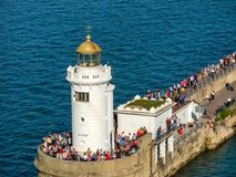 Lighthouse near New Port at Bilbao, Spain. BILBAO, SPAIN - MARCH 28 2017: Lighthouse near new port at harbor Bilbao, people in hundreds came to welcomes stock images