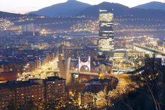 Wonders of Bilbao at sunset. BILBAO, SPAIN - MARCH 11, 2017: Wonders of Bilbao at sunset: La Salve bridge, Guggenheim museum, the Iberdrola tower and the San Stock Photo