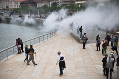 Bilbao, Spain - May 17, 2017: people walking and sightseeing city of bilbao in water smoke attraction animation by museum guggenhe. People walking and Stock Photos