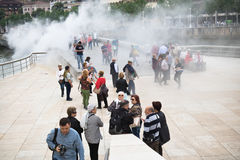 Bilbao, Spain - May 17, 2017: people walking and sightseeing city of bilbao in water smoke attraction animation by museum guggenhe. People walking and Stock Photo